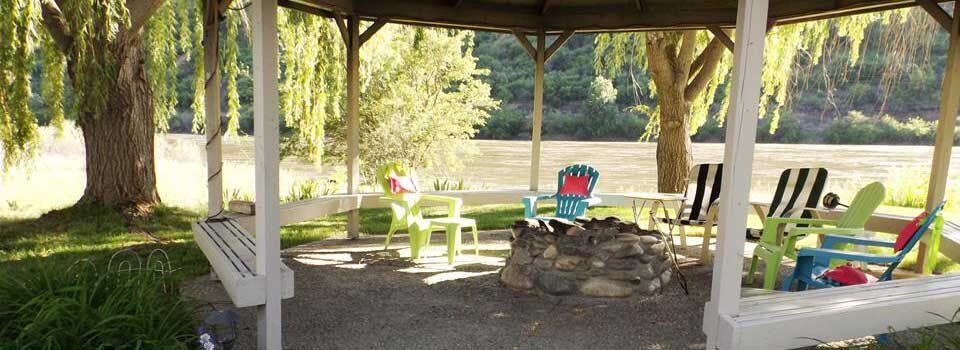 Our river front Swiftwater RV Gazebo is a popular spot for social gatherings around the fire pit.